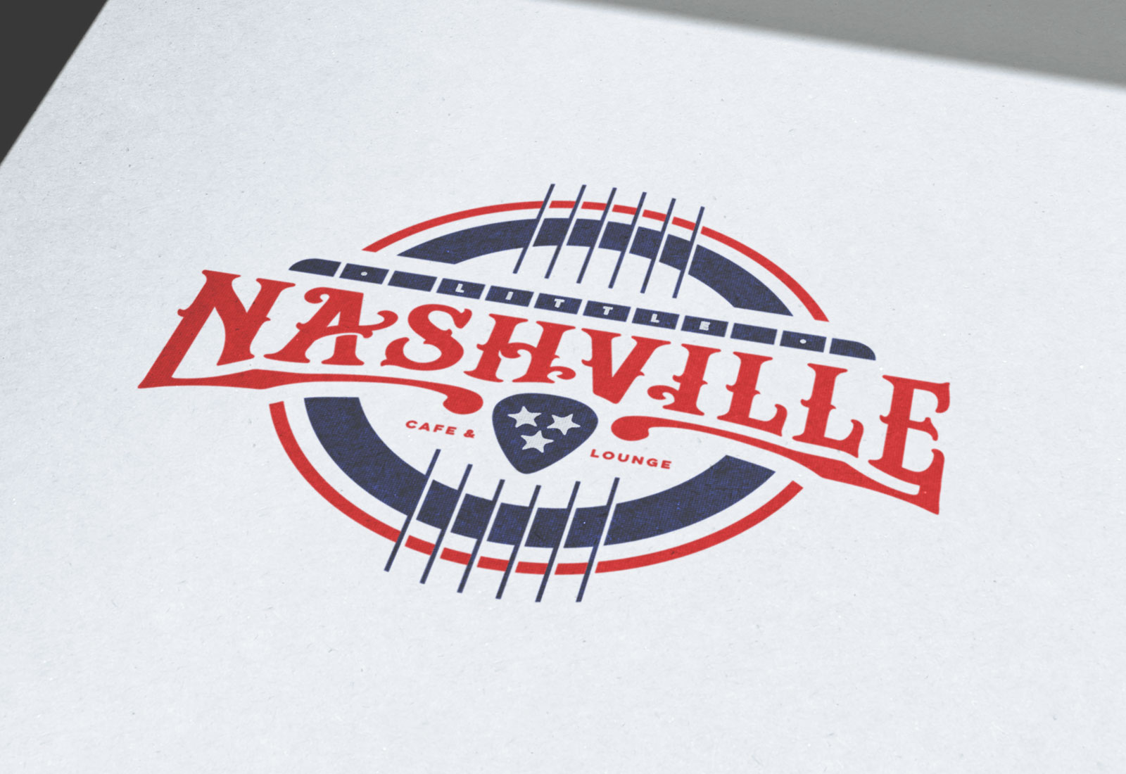 Little Nashvill Logo Design On Printed Paper