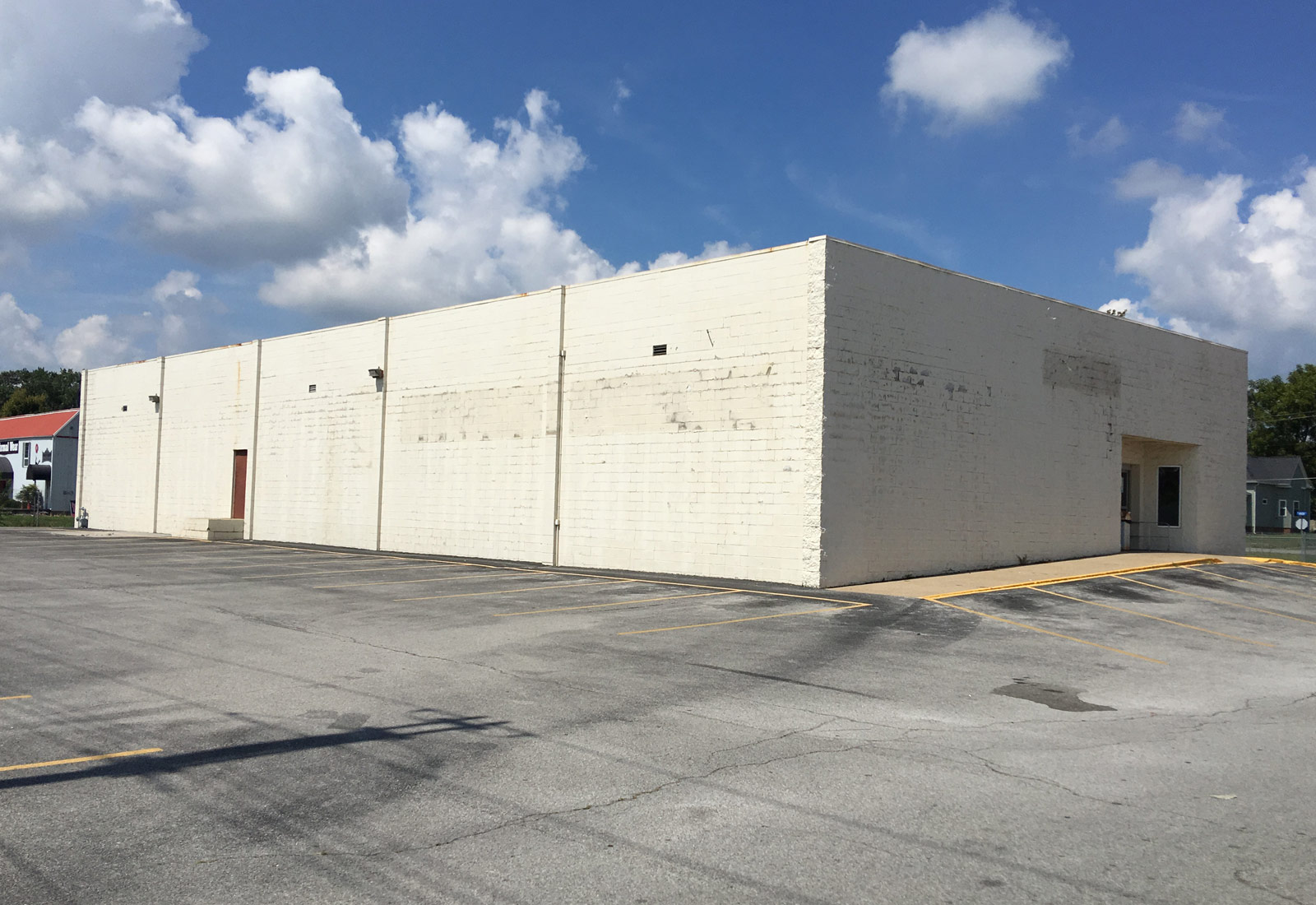 Luckys Liquors Building Before Remodel & Store Design
