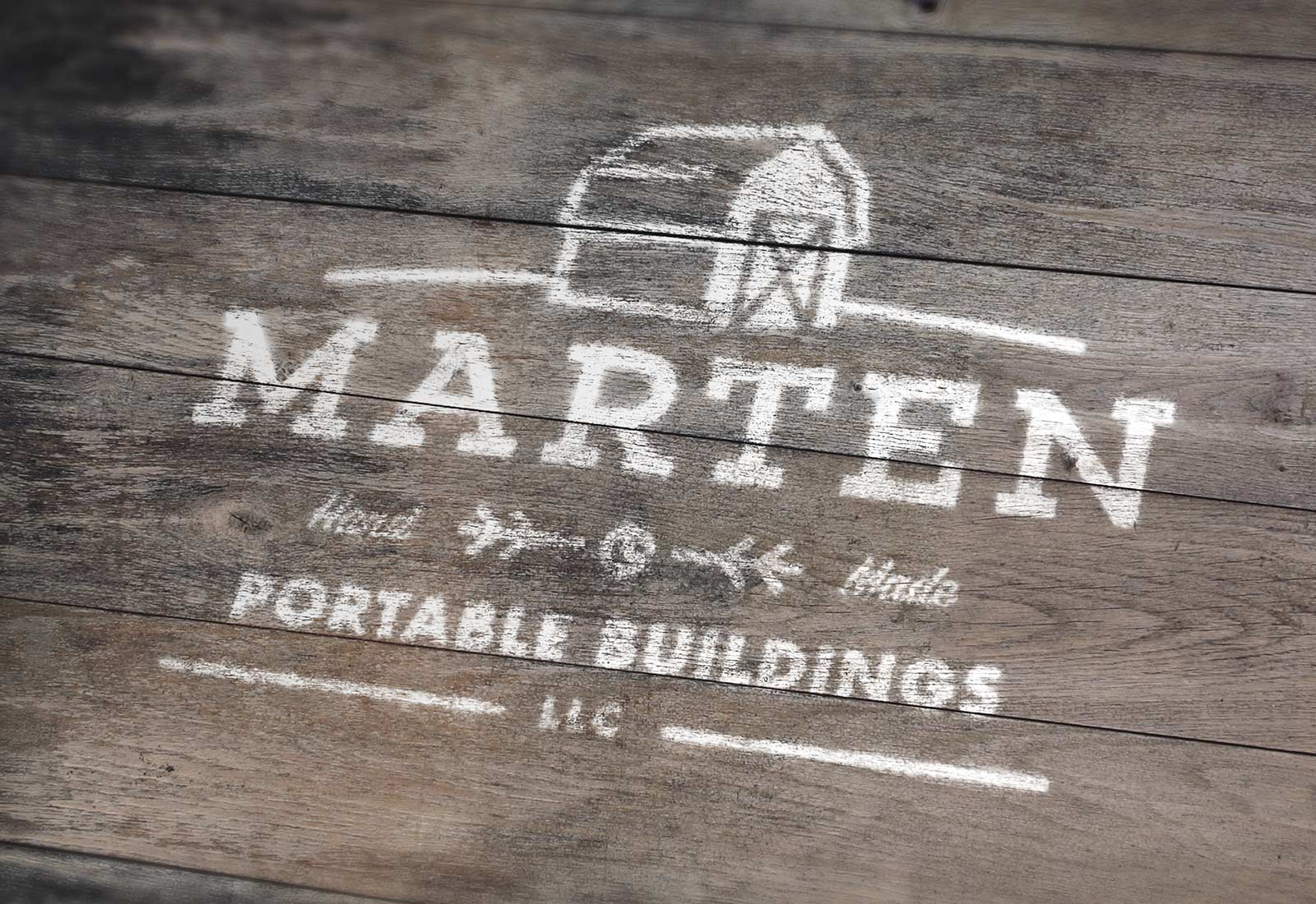Marten Portable Buildings Logo Painted On Wood